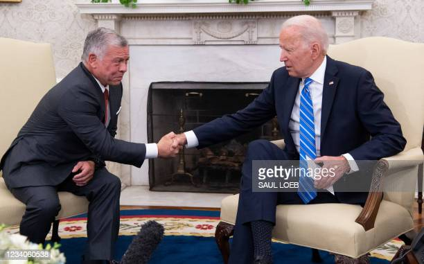 President Joe Biden and Jordan's King Abdullah II shake hands during a meeting in the Oval Office of the White House in Washington, DC, on July 19,...