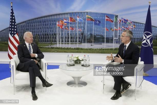 President Joe Biden and NATO Secretary General Jens Stoltenberg meet during a NATO summit at the North Atlantic Treaty Organization headquarters in...