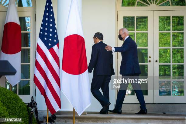President Joe Biden and Prime Minister Yoshihide Suga of Japan leave the Rose Garden at the conclusion of a news conference at the White House on...