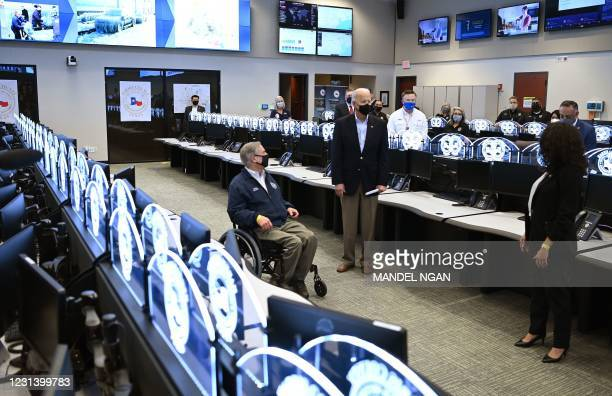 President Joe Biden and Texas Governor Greg Abbott arrive at the Harris County Emergency Operations Center in Houston, Texas on February 26, 2021. -...