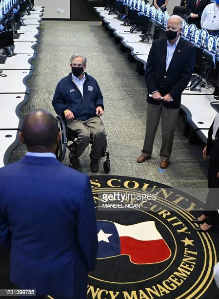 President Joe Biden and Texas Governor Greg Abbott listen to officials at the Harris County Emergency Operations Center in Houston, Texas on February...