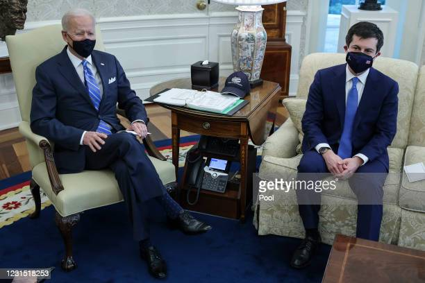President Joe Biden and Transportation Secretary Pete Buttigieg meet with a bipartisan group of House members on infrastructure in the Oval Office of...