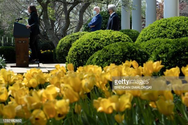 President Joe Biden and US Attorney General Merrick Garland listen as US Vice President Kamala Harris speaks from the Rose Garden of the White House...