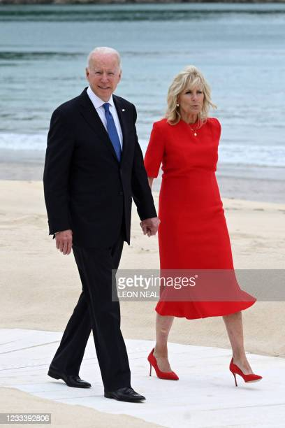 President Joe Biden and US First Lady Jill Biden arrive for an offial photograph at the start of the G7 summit in Carbis Bay, Cornwall on June 11,...