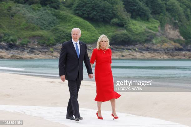 President Joe Biden and US First Lady Jill Biden arrive for the welcome prior to the start of the G7 summit in Carbis Bay, Cornwall on June 11, 2021....