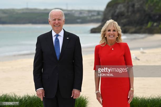 President Joe Biden and US First Lady Jill Biden pose for an official photograph at the start of the G7 summit in Carbis Bay, Cornwall, south-west...