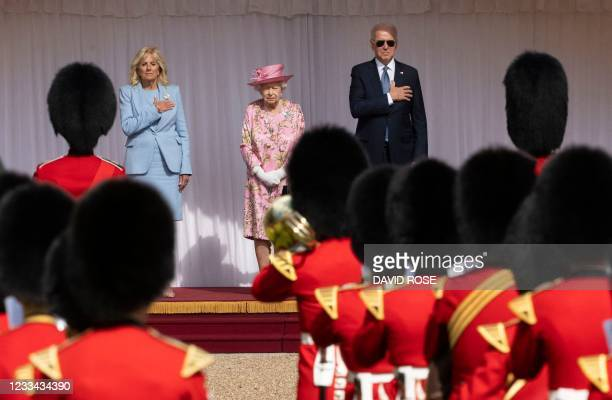 President Joe Biden and US First Lady Jill Biden stand beside Britain's Queen Elizabeth II to watch the military march past at Windsor Castle in...