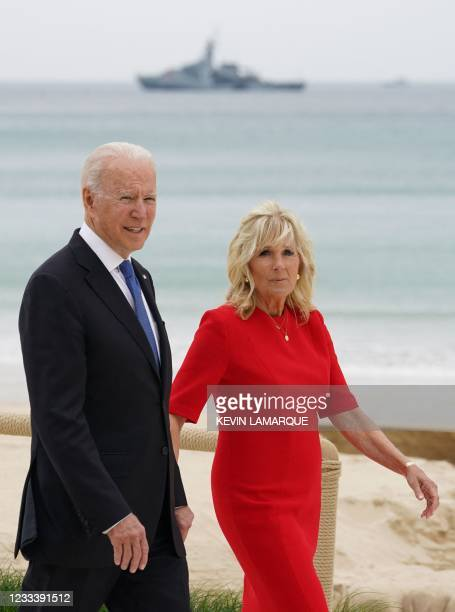President Joe Biden and US First Lady Jill Biden walk along the beach during the G7 summit in Carbis Bay, Cornwall, south-west England on June 11,...