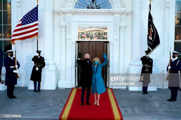 President Joe Biden and US First Lady Jill Biden wave as they arrive at the North Portico of the White House on January 20 in Washington, DC.