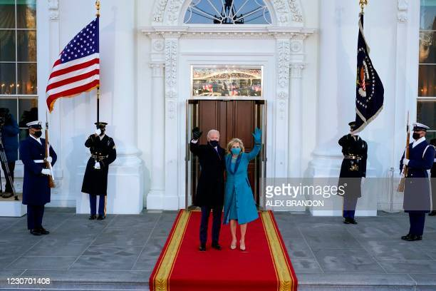 President Joe Biden and US First Lady Jill Biden , wave as they arrive at the White House in Washington, DC, after Biden and Harris were sworn in at...