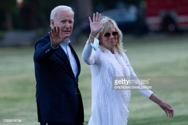 President Joe Biden and US first lady Jill Biden wave as they walk from Marine One upon arrival on the Ellipse outside the White House May 23 in...
