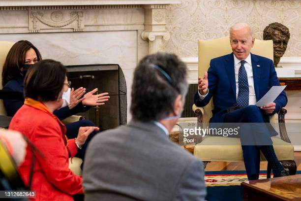 President Joe Biden and Vice President Kamala Harris applaud for Sen. Mazie Hirono during a meeting with members of the Congressional Asian Pacific...