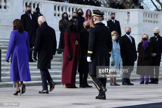 President Joe Biden and Vice President Kamala Harris depart a wreath-laying ceremony at Arlington National Cemetery's Tomb of the Unknown Soldier...