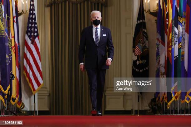President Joe Biden approaches the podium to deliver a primetime address to the nation from the East Room of the White House March 11, 2021 in...