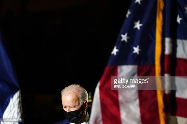 President Joe Biden arrives to pay his respects to late US Capitol Police officer Brian Sicknick, as he lies in honor in the Capitol Rotunda in...