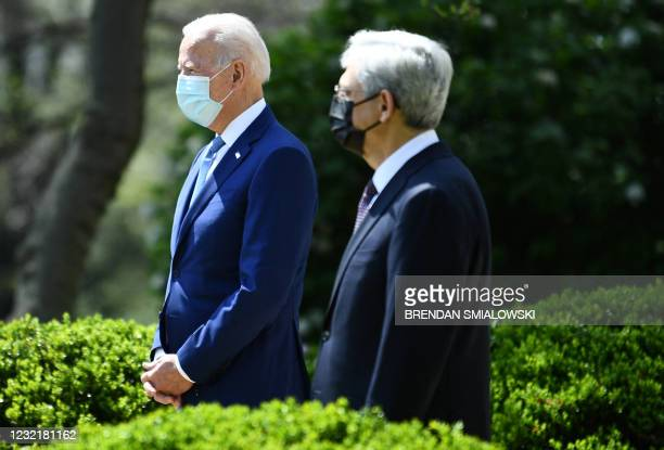 President Joe Biden arrives with Attorney General Merrick Garland to speak about gun violence prevention in the Rose Garden of the White House in...
