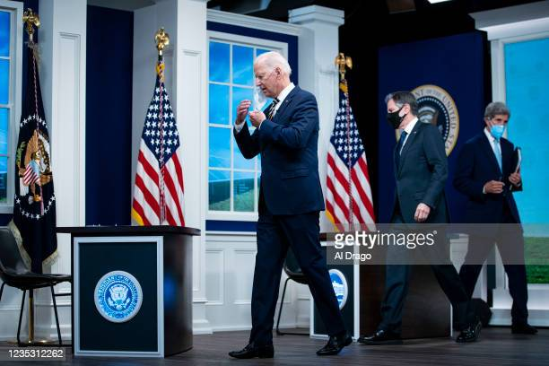 President Joe Biden arrives with U.S. Secretary of State Antony Blinken, and United States Special Presidential Envoy for Climate John Kerry for a...