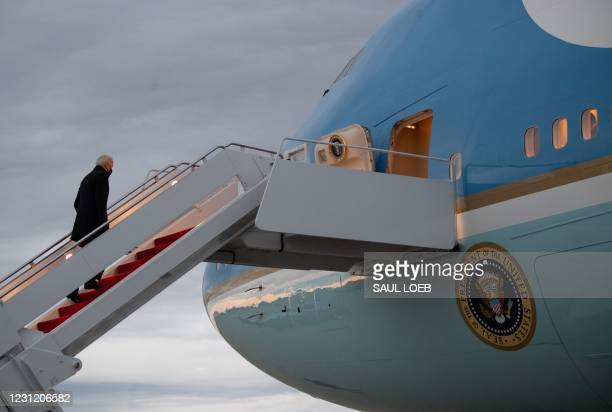 President Joe Biden boards Air Force One upon prior to departure from Joint Base Andrews in Maryland, February 16 as he travels to Milwaukee,...