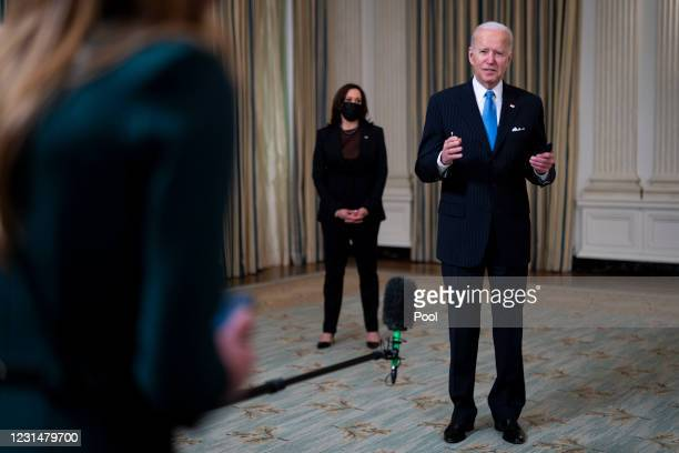 President Joe Biden briefly speaks to reporters after delivering remarks in the State Dining Room of the White House on March 2, 2021 in Washington,...
