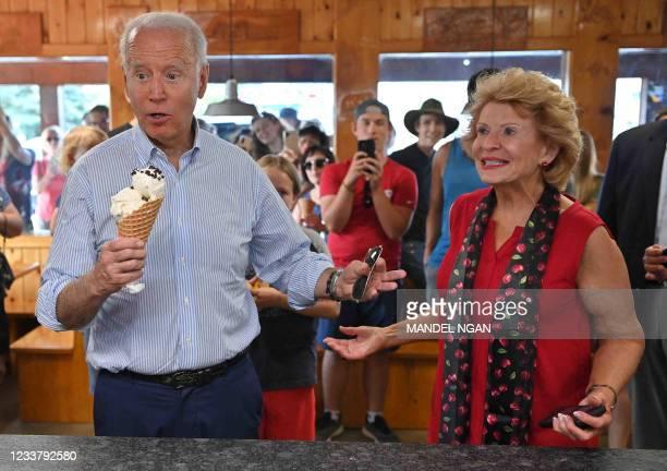 President Joe Biden buys ice cream as Michigan Senators Debbie Stabenow looks on at Moomers Homemade Ice Cream in Traverse City, Michigan on July 3,...