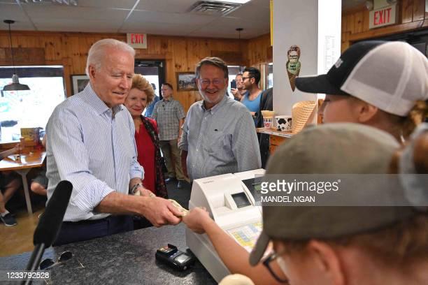 President Joe Biden buys ice cream at Moomers Homemade Ice Cream in Traverse City, Michigan on July 3, 2021.