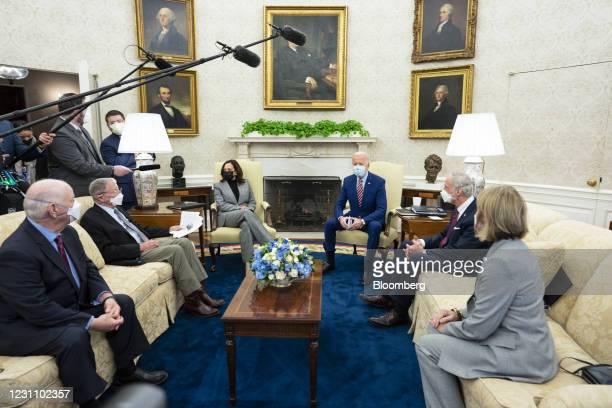 President Joe Biden, center right, and U.S. Vice President Kamala Harris, center left, wear protective masks while meeting with Senator Shelley Moore...