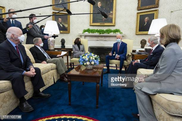 President Joe Biden, center right, wears a protective mask while speaking during a meeting with U.S. Vice President Kamala Harris, center left, and...