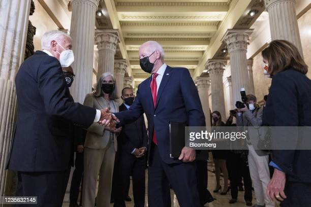 President Joe Biden, center, shakes hands with House Majority Leader Steny Hoyer, a Democrat from Maryland, before a House Democratic caucus meeting...