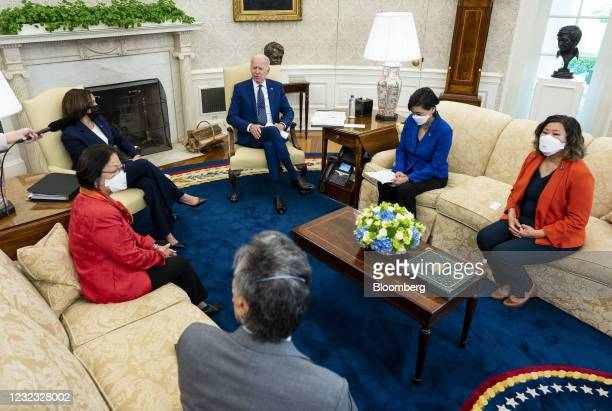 President Joe Biden, center, speaks as U.S. Vice President Kamala Harris, left, listens during a meeting with the Congressional Asian Pacific...