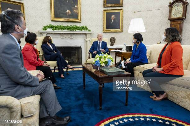 President Joe Biden, center, speaks as U.S. Vice President Kamala Harris, third left, listens during a meeting with the Congressional Asian Pacific...