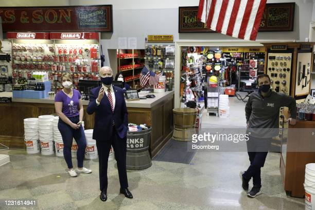 President Joe Biden, center, speaks during a visit at W.S. Jenks & Son hardware store in Washington, D.C., U.S., on Tuesday, March 9, 2021. The new...
