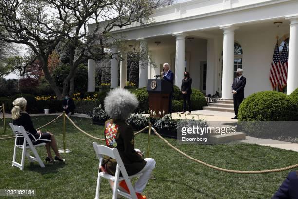 President Joe Biden, center, speaks in the Rose Garden of the White House in Washington, D.C., U.S., on Thursday, April 8, 2021. Biden announced a...
