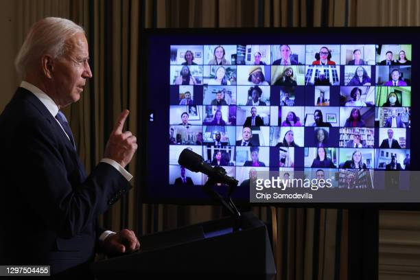 President Joe Biden conducts a virtual swearing in ceremony for members of his new administration via Zoom just hours after his inauguration in the...