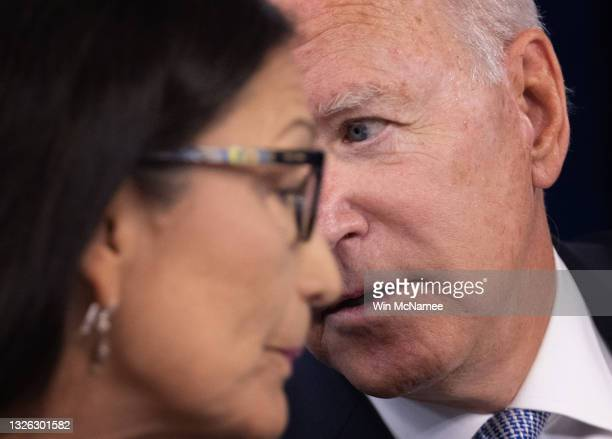 President Joe Biden confers with Interior Secretary Deb Haaland during an event with governors of western states and members of his cabinet June 30,...