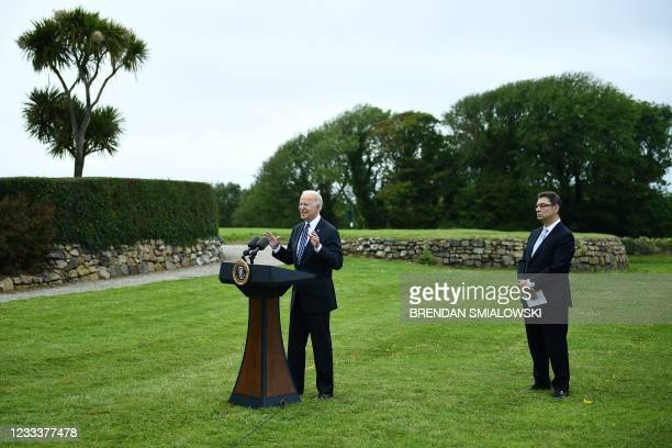 President Joe Biden delivers a speech on the COVID-19 pandemic, as Pfizer CEO Albert Bourla stands alongside him, in St Ives, Cornwall on June 10...