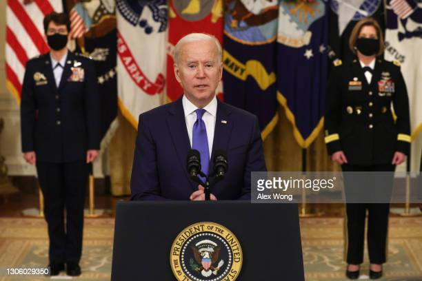 President Joe Biden delivers remarks on International Women's Day as Air Force General Jacqueline Van Ovost and Army Lieutenant General Laura...