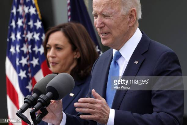President Joe Biden delivers remarks on the COVID-19 response and vaccination program as Vice President Kamala Harris listens in the Rose Garden of...
