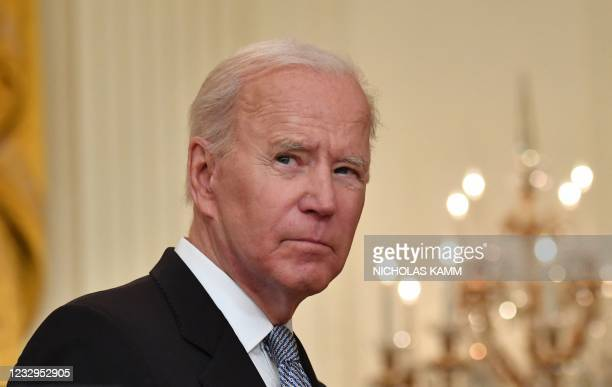 President Joe Biden delivers remarks on the COVID-19 response and the vaccination in the East Room at the White House in Washington, DC on May 17,...
