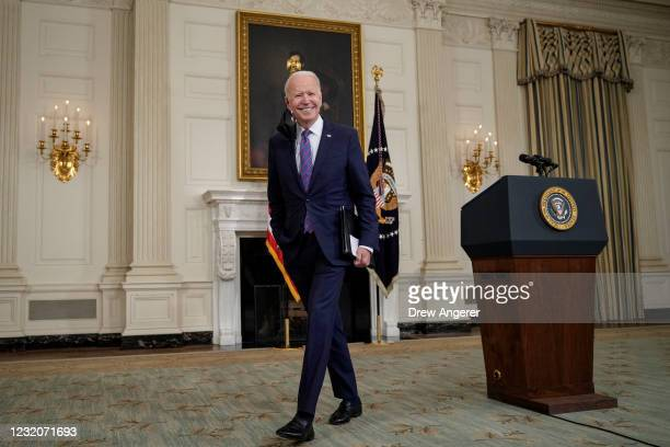 President Joe Biden departs after speaking about the March jobs report in the State Dining Room of the White House on April 2, 2021 in Washington,...