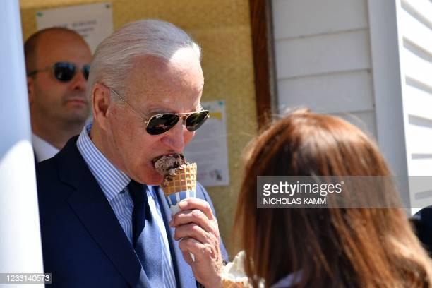 President Joe Biden eats an ice cream at Honey Hut Ice Cream in Cleveland, Ohio, on May 27, 2021.