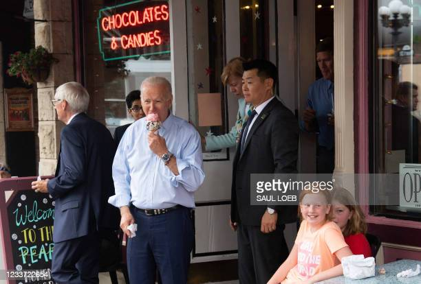 President Joe Biden eats an ice cream cone while visiting the The Pearl Ice Cream Parlor & Confectionery in La Crosse, Wisconsin, June 29, 2021.