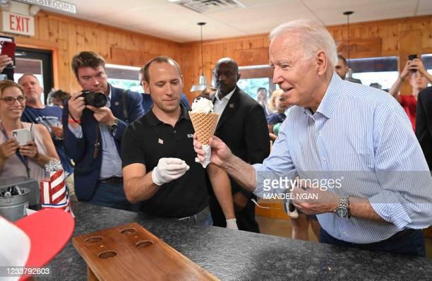 President Joe Biden eats ice cream at Moomers Homemade Ice Cream in Traverse City, Michigan on July 3, 2021.