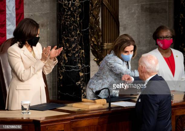 President Joe Biden elbow bumps Speaker of the House Nancy Pelosi, D-Calif., as Vice President Kamala Harris claps at the end of his address to the...
