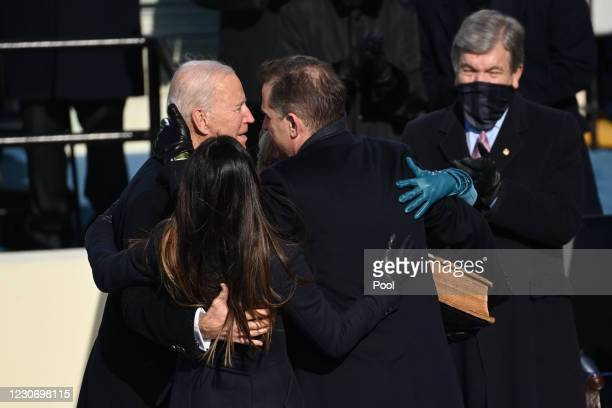 President Joe Biden embraces his son Hunter Biden after being sworn in as the 46th US President during the 59th Presidential Inauguration at the U.S....