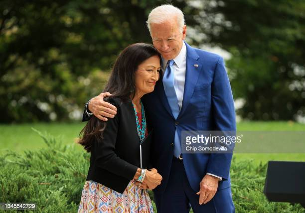 President Joe Biden embraces Secretary of the Interior Deb Haaland before announcing the expansion of areas of three national monuments at the White...