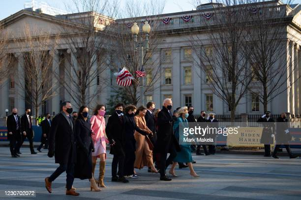 President Joe Biden, First Lady Dr. Jill Biden and family walk the abbreviated parade route after Biden's inauguration on January 20, 2021 in...