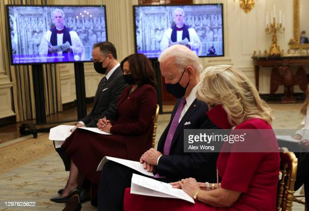 President Joe Biden , first lady Dr. Jill Biden , Vice President Kamala Harris and Second Gentleman Doug Emhoff bow their heads as they watch the...
