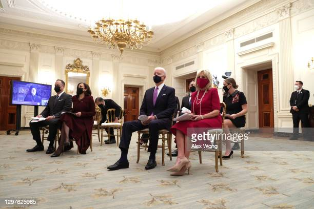 President Joe Biden , first lady Dr. Jill Biden , Vice President Kamala Harris and Second Gentleman Doug Emhoff watch the virtual presidential...