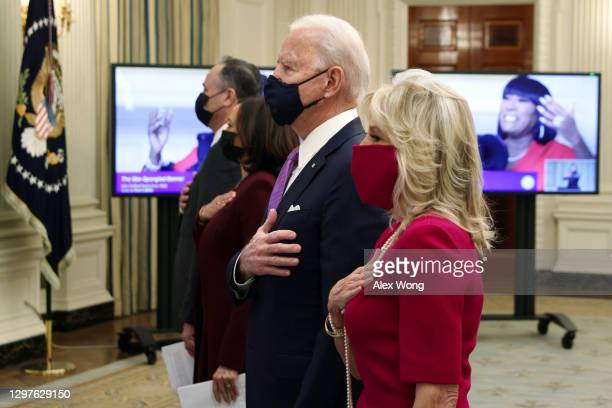 President Joe Biden , first lady Dr. Jill Biden , Vice President Kamala Harris and Second Gentleman Doug Emhoff listen to the national anthem as they...