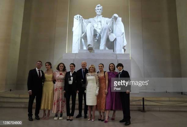 President Joe Biden, first lady Jill Biden and their family pose at the Lincoln Memorial where the president participated in a televised ceremony on...